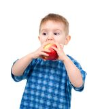 Child eats apple Stock Photography