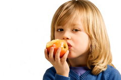 Child eats apple Stock Images
