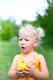 A child eats an apple Royalty Free Stock Images