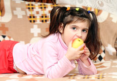 Child eats Stock Images
