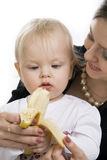 The child eats a banana. Stock Photography