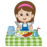 The child eats breakfast that can affect the growth of children Stock Photos
