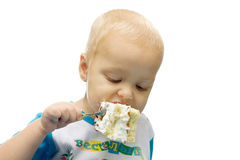 Child eats cake Stock Photos
