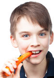 Child eats carrot Stock Image