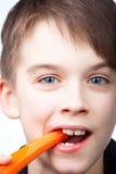 Child eats carrot Stock Photo