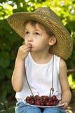 Child eats a cherry Royalty Free Stock Photo