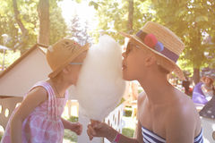 Child eats cotton candy with mom in city street Royalty Free Stock Photography