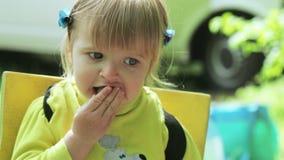 Child eats cucumber stock footage