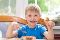 The child eats a dessert Stock Photos