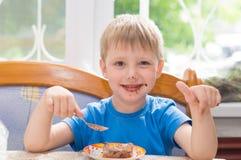 The child eats a dessert Stock Photos