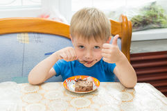 The child eats a dessert Royalty Free Stock Image