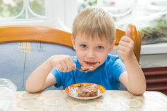 The child eats a dessert Royalty Free Stock Photography