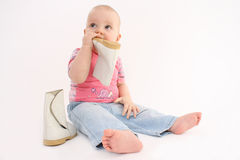 The child eats the footwear Stock Photography