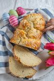 Child eats Fresh baked Easter Brioche stock images