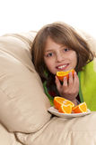 Child eats fruit Royalty Free Stock Images