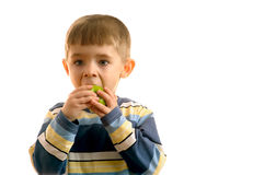 Child eats green apple Stock Photos