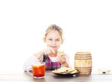 Child eats honey Stock Images