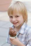 Child eats ice-cream Royalty Free Stock Image