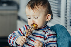 The child eats Lunch,meat chicken Royalty Free Stock Photos