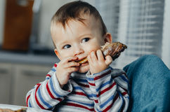 The child eats Lunch,meat chicken Royalty Free Stock Images