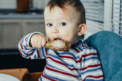 The child eats Lunch,meat chicken Royalty Free Stock Image