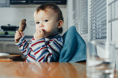 The child eats Lunch,meat chicken Royalty Free Stock Photography