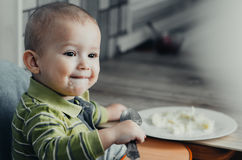 The child eats mashed potatoes Royalty Free Stock Photos