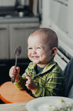 The child eats mashed potatoes Royalty Free Stock Images