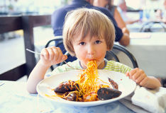 The child eats noodles Royalty Free Stock Image