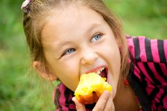 Child eats a peach Royalty Free Stock Images