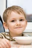 Child eats porridge Royalty Free Stock Photos