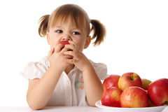 Child eats red apple Royalty Free Stock Photography