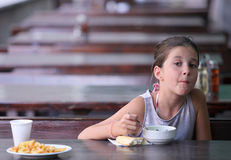 Child eats in a restaurant Stock Photos
