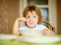 Child eats with spoon Royalty Free Stock Photos