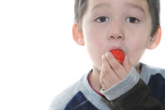 The child eats strawberry Stock Photography