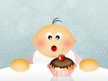 Child eats sweets Royalty Free Stock Images