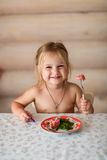 Child eats at the table Stock Photos