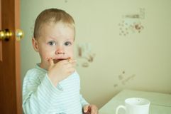 Child eats with tears Royalty Free Stock Image