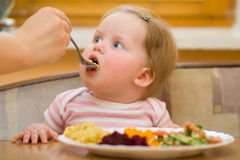 The child eats a vegetable salad Royalty Free Stock Image