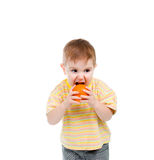 Child eats vented orange Stock Photography