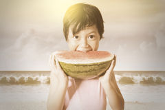 Child eats a watermelon outdoors Royalty Free Stock Images