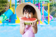 Child eats watermelon at pool Stock Photography