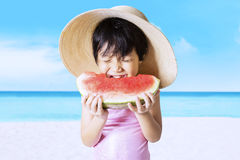 Child eats watermelon on the seaside Royalty Free Stock Photos