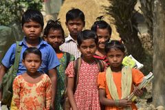 Child Education in Bangladesh. Some of the village children standing with text books in front of their school in Bangladesh unique editorial photograph stock photography