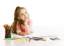 Child Education Concept, Kid Girl Drawing and Dreaming School. Lying down on White background stock images