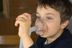 Child with electric nebulizer Royalty Free Stock Photography