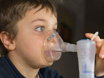 Child with electric nebulizer Royalty Free Stock Photo