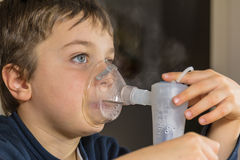 Child with electric nebulizer Royalty Free Stock Photos