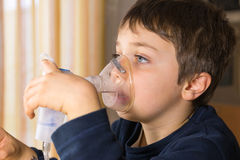 Child with electric nebulizer Stock Image