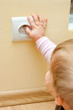Child at electric socket Royalty Free Stock Image